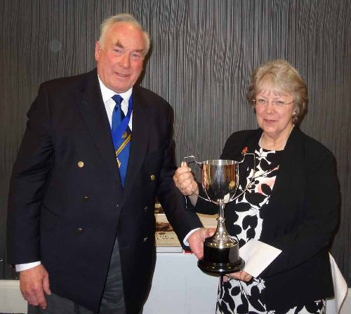 Stephanie Dow is presented with the David St John Thomas silver cup by Graham Wild for the 2016 Transport History Book of the Year award (Photo: Stephen Rowson)