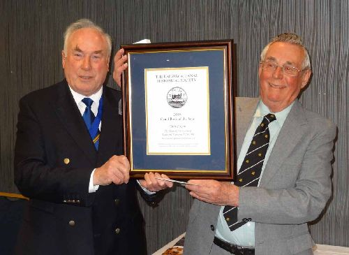 Tom Foxon is presented with his certificate and cheque by Graham Wild for the 2016 Canal Book of the Year award (Photo Stephen Rowson)